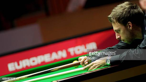 Judd Trump of England plays a shot against Shaun Murphy of England on day five of 2014 Kreativ Dental Ruhr Open at RWESporthalle on November 23 2014...