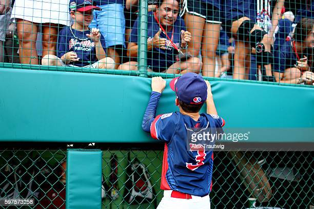 Jude Abbadessa of the MidAtlantic Team from New York celebrates with fans after defeating the AsiaPacific Team from South Korea in the World Series...
