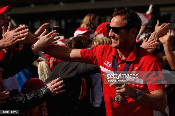 Jude Bolton arrives prior to Swans players being presented to supporters at Lakeside Stadium during a Sydney Swans official AFL Fan Day at Albert...