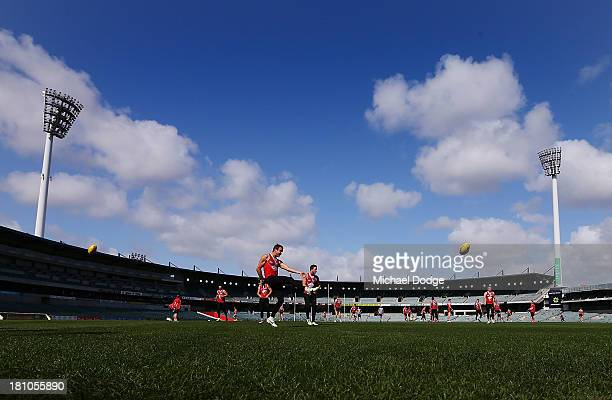 Jude Bolton kicks the ball during a Sydney Swans AFL training session at Patersons Stadium on September 19 2013 in Perth Australia