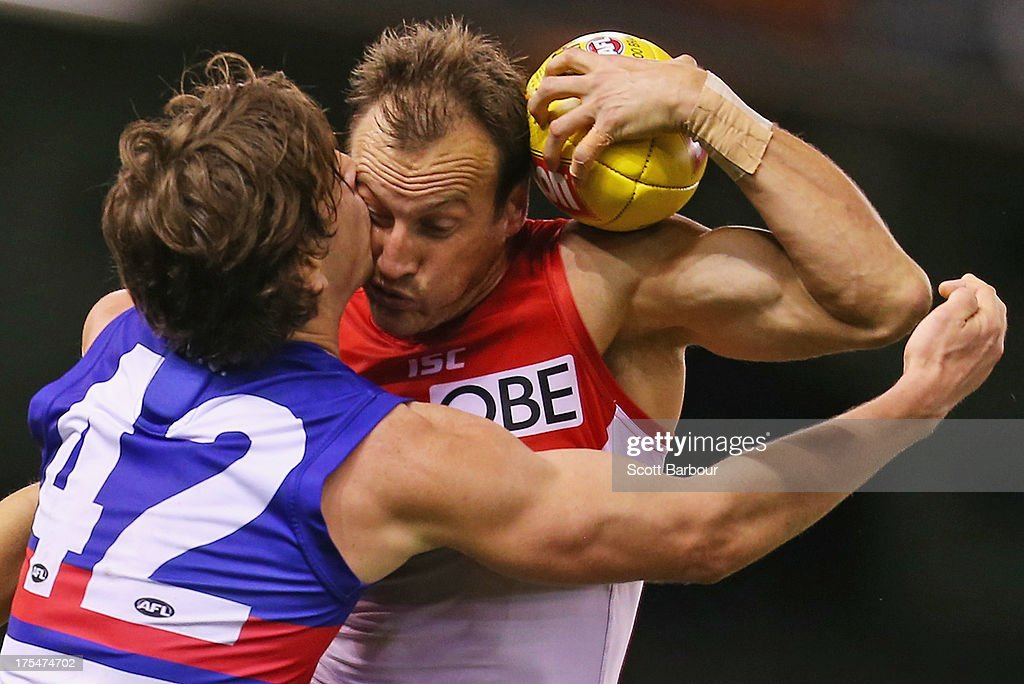 <a gi-track='captionPersonalityLinkClicked' href=/galleries/search?phrase=Jude+Bolton&family=editorial&specificpeople=213481 ng-click='$event.stopPropagation()'>Jude Bolton</a> of the Swans and Liam Picken of the Bulldogs compete for the ball during the round 19 AFL match between the Western Bulldogs and the Sydney Swans at Etihad Stadium on August 4, 2013 in Melbourne, Australia.