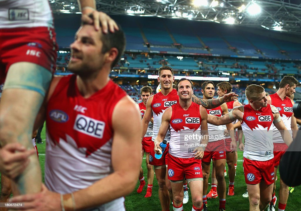 <a gi-track='captionPersonalityLinkClicked' href=/galleries/search?phrase=Jude+Bolton&family=editorial&specificpeople=213481 ng-click='$event.stopPropagation()'>Jude Bolton</a> of the Swans celebrates after the AFL First Semi Final match between the Sydney Swans and the Carlton Blues at ANZ Stadium on September 14, 2013 in Sydney, Australia.