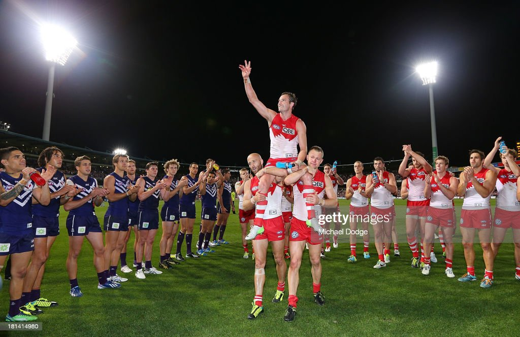 <a gi-track='captionPersonalityLinkClicked' href=/galleries/search?phrase=Jude+Bolton&family=editorial&specificpeople=213481 ng-click='$event.stopPropagation()'>Jude Bolton</a> of the Swans gets carried off for his last game by Jarrad Mcveigh (L) and <a gi-track='captionPersonalityLinkClicked' href=/galleries/search?phrase=Ryan+O%27Keefe&family=editorial&specificpeople=214559 ng-click='$event.stopPropagation()'>Ryan O'Keefe</a> during the AFL Second Preliminary Final match between the Fremantle Dockers and the Sydney Swans at Patersons Stadium on September 21, 2013 in Perth, Australia.