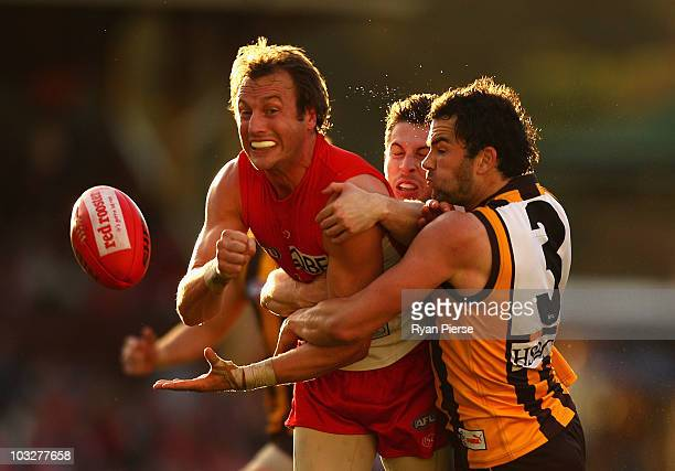 Jude Bolton of the Swans is tackled by Jordan Lewis of the Hawks during the round 19 AFL match between the Sydney Swans and the Hawthorn Hawks at the...