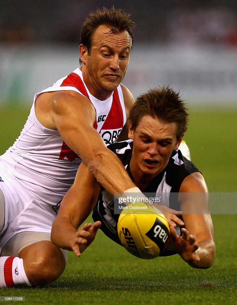 Jude Bolton of the Swans tackles Jye Bolton of the Magpies during the NAB Cup Quarter Final match between the Collingwood Magpies and the Sydney Swans at Etihad Stadium on February 25, 2011 in Melbourne, Australia.