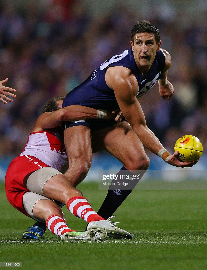 <a gi-track='captionPersonalityLinkClicked' href=/galleries/search?phrase=Jude+Bolton&family=editorial&specificpeople=213481 ng-click='$event.stopPropagation()'>Jude Bolton</a> of the Swans tackles <a gi-track='captionPersonalityLinkClicked' href=/galleries/search?phrase=Matthew+Pavlich&family=editorial&specificpeople=208649 ng-click='$event.stopPropagation()'>Matthew Pavlich</a> of the Dockers during the AFL Second Preliminary Final match between the Fremantle Dockers and the Sydney Swans at Patersons Stadium on September 21, 2013 in Perth, Australia.