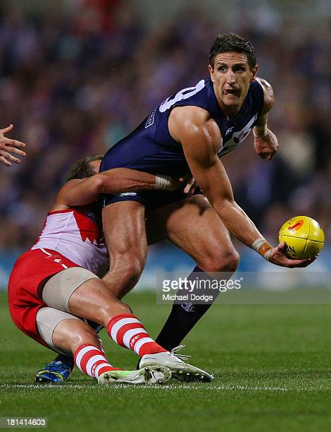 Jude Bolton of the Swans tackles Matthew Pavlich of the Dockers during the AFL Second Preliminary Final match between the Fremantle Dockers and the...