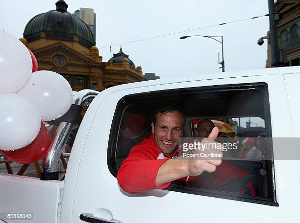 Jude Bolton of the Swans waves to the fans during the 2012 AFL Grand Final Parade on September 28 2012 in Melbourne Australia
