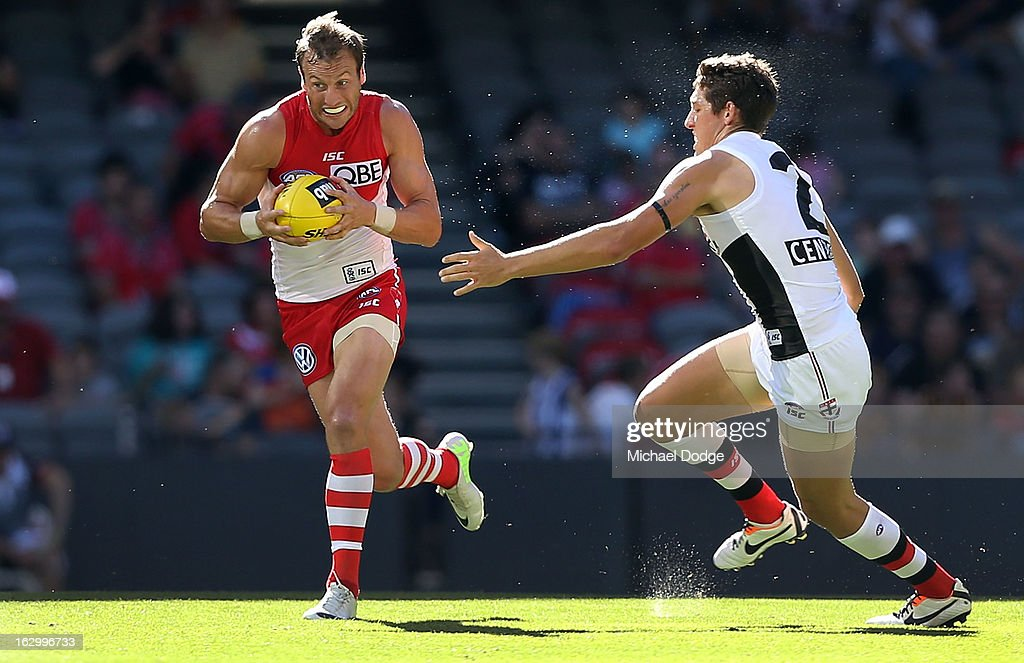 Jude Bolton of the Sydney Swans runs with the ball away from Arryn Siposs of the St.Kilda Saints during the round two AFL NAB Cup match between the St Kilda Saints and the Sydney Swans at Etihad Stadium on March 3, 2013 in Melbourne, Australia.