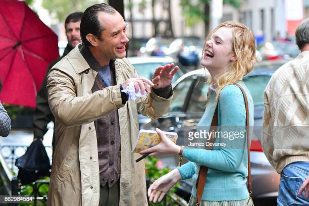 Jude Law and Elle Fanning seen on location for Woody Allen's untitled movie on October 18 2017 in New York City
