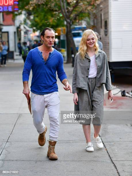 Jude Law and Elle Fanning seen on location for Woody Allen's untitled movie in Tribeca on October 19 2017 in New York City