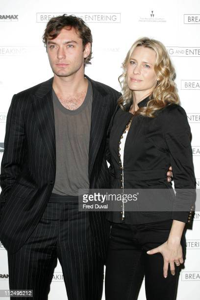 Jude Law and Robin Wright Penn during The Times BFI 50th London Film Festival 'Breaking and Entering' Photocall at Dorchester Hotel in London Great...