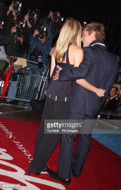Jude Law and Sienna Miller arrive for the world charity premiere of Alfie at the Empire Leicester Square in central London in aid of MakeAWish...