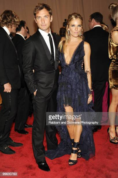 Jude Law and Sienna Miller attend the Costume Institute Gala Benefit to celebrate the opening of the 'American Woman Fashioning a National Identity'...