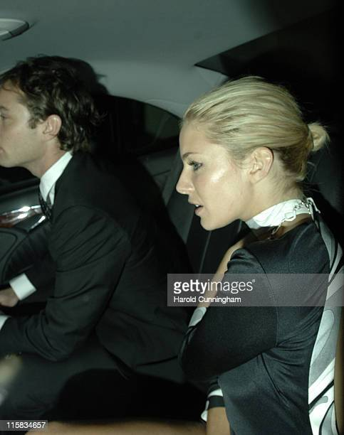 Jude Law and Sienna Miller during 2006 Chain of Hope Masked Ball Arrivals at The Dorchester in London Great Britain