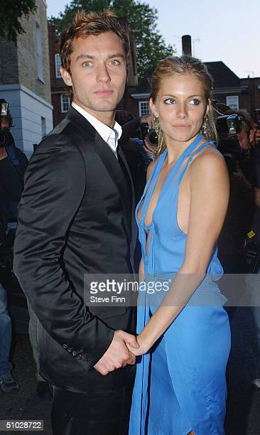 Jude Law and Sienna Miller leave David Frost's Summer Party at Carlisle Square on July 6 2004 in London