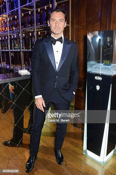 Jude Law attends JOHNNIE WALKER BLUE LABEL Presents SYMPHONY IN BLUE A Journey To The Centre of The Glass on September 17 2014 in London England