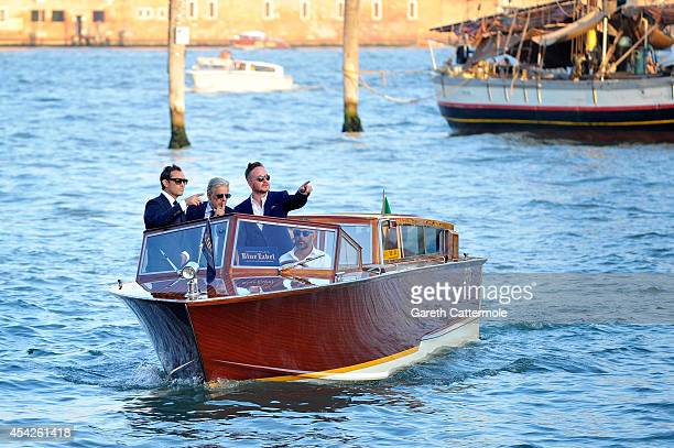 Jude Law Giancarlo Giannini and Jake Scott arrive via speed boat to the Westin Europa Regina Terrace for the JOHNNIE WALKER BLUE LABEL drinks...
