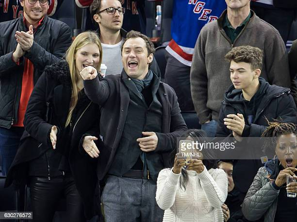 Jude Law Iris Law and Rudy Law are seen at Madison Square Garden on December 18 2016 in New York City