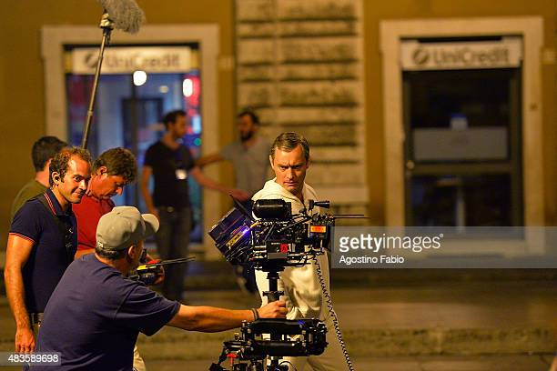 Jude Law is seen on set filming the new TV series of Paolo Sorrentino 'The Young Pope' near Saint Peter's church on August 11 2015 in Rome Italy