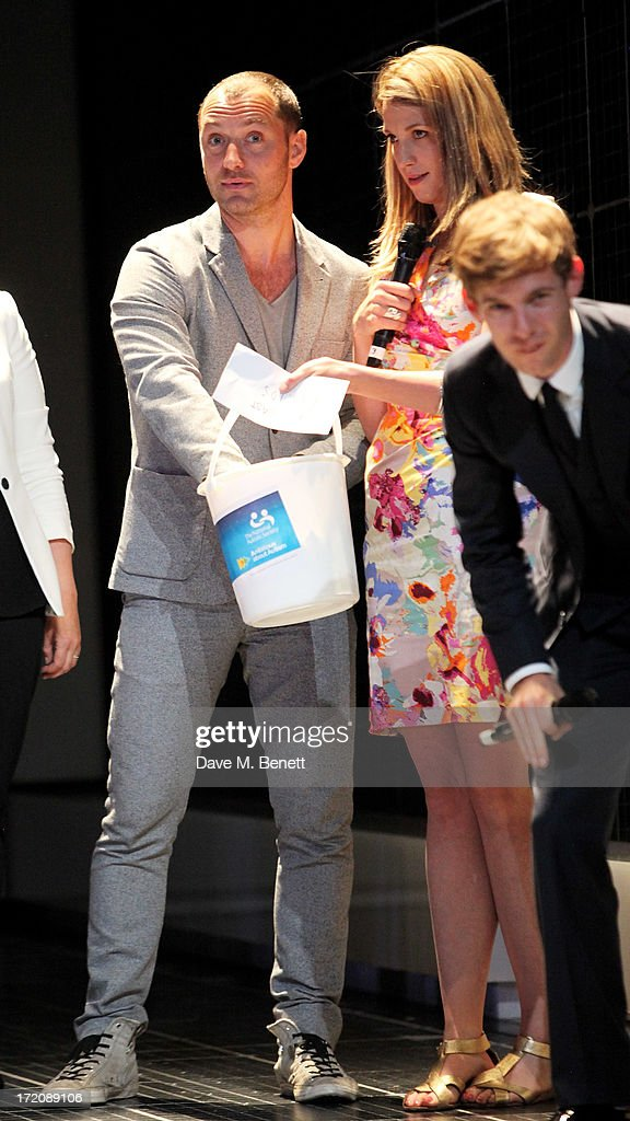 Jude Law, Katy Rudd and Luke Treadaway speak on stage at 'A Curious Night at the Theatre', a charity gala evening to raise funds for Ambitious about Autism and The National Autistic Society, at The Apollo Theatre on July 1, 2013 in London, England.