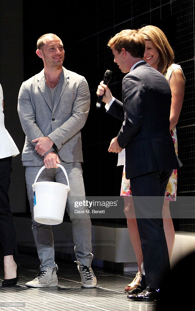 Jude Law, Luke Treadaway and Katy Rudd speak on stage at 'A Curious Night at the Theatre', a charity gala evening to raise funds for Ambitious about Autism and The National Autistic Society, at The Apollo Theatre on July 1, 2013 in London, England.