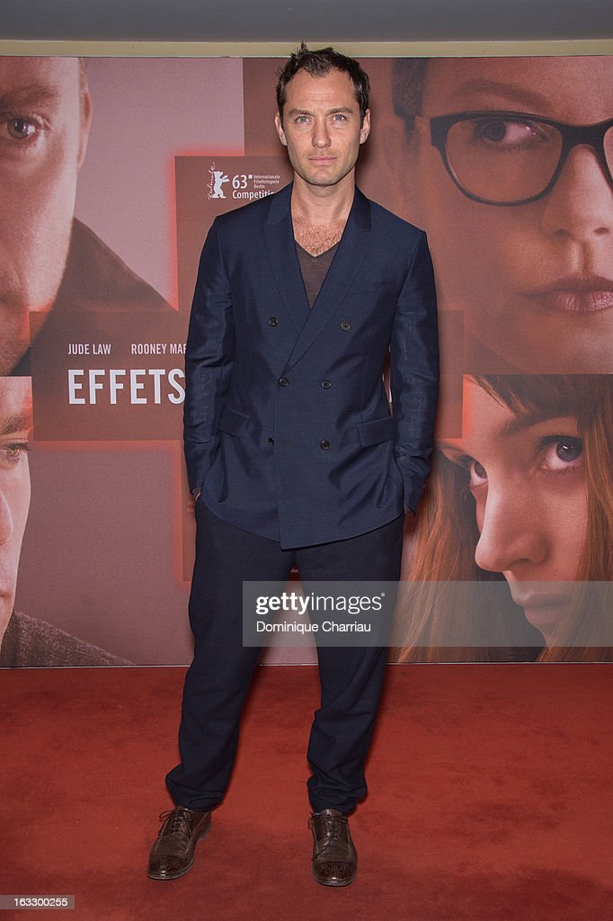 <a gi-track='captionPersonalityLinkClicked' href=/galleries/search?phrase=Jude+Law&family=editorial&specificpeople=156401 ng-click='$event.stopPropagation()'>Jude Law</a> poses as he attends the 'Effet Secondaires' Premiere at UGC Cine Cite des Halles on March 7, 2013 in Paris, France.