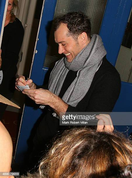 Jude Law signing autographs at the Noel Coward theatre on December 10 2013 in London England