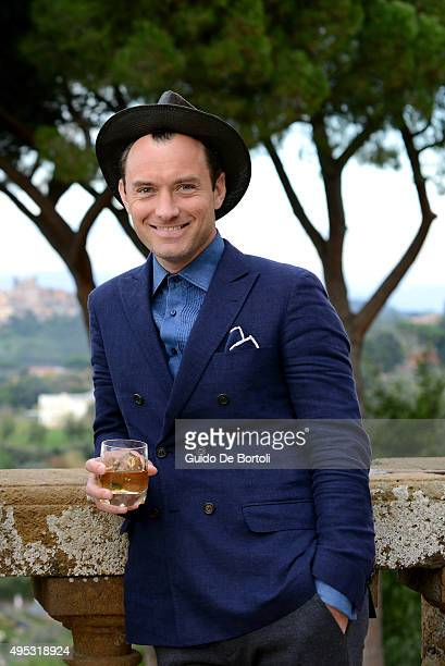 Jude Law toasts at the photocall of Johnnie Walker Blue Label's The Gentleman's Wager II at Villa Mondragone on October 31 2015 in Rome Italy