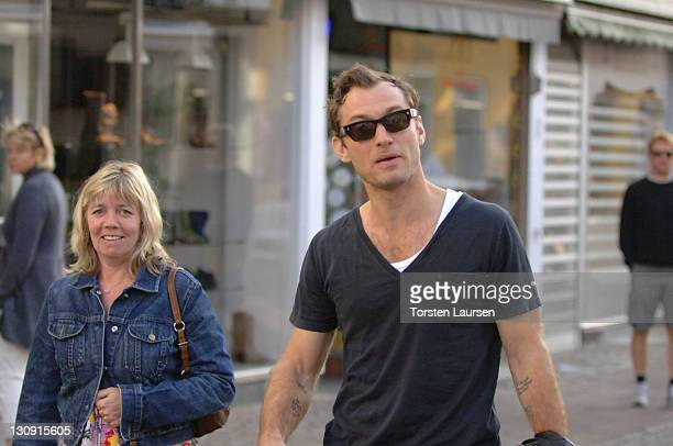 Jude Law walks with an unidentified woman along a street on August 30 2009 in Helsingor Denmark