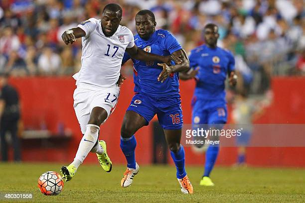 Judelin Aveska of Haiti defends Jozy Altidore of United States during the 2015 CONCACAF Gold Cup match between United States and Haiti at Gillette...
