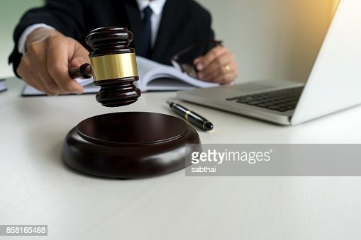 Judge adjudicate in courtroom Referee hammer the gavel : Stock Photo