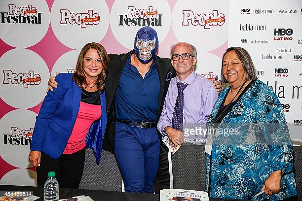 TV Judge Ana Maria Polo luchador Blue Demon Jr and activist Rosie Castro pose for a photograph with a fan during HBO Latino Habla Men at People en...