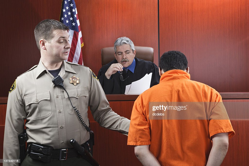 Judge and Prisoner in Courtroom