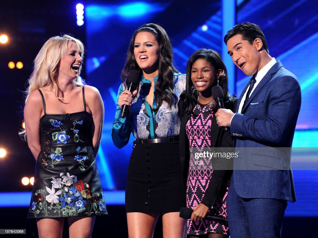Judge Britney Spears, host Khloe Kardashian, eliminated contestant Diamond White and host Mario Lopez onstage at FOX's 'The X Factor' Season 2 Top 6 to 4 Live Elimination Show on December 6, 2012 in Hollywood, California.
