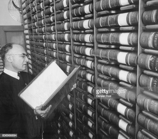Judge Brofman with Small Portion of County Court Records Hundreds of books contain records of probate cases dating all the way back to 1864 Credit...