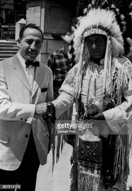 Judge Chief Join In Peace Pact Superior Court Judge Mitchel Johns makes peace pact with Sioux Chief Charlie Red Cloud during the dancers' appearance...