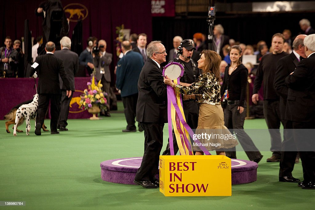 Judge Cindy Vogels presents Pekingese Malachy and David Fitzpatrick, co-owner and handler, a ribbon after winning Best in Show at the Westminster Kennel Club Dog Show on February 14, 2012 in New York City. The Westminster Kennel Club Dog Show was first held in 1877, is the second-longest continuously held sporting event in the U.S., second only to the Kentucky Derby.