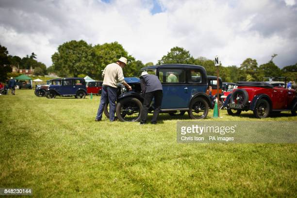 A judge closely inspects an entry at the 50th Austin Seven Rally at the National Motor Museum in Beaulieu Hampshire