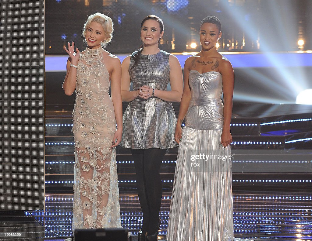 Judge Demi Lovato (C) and contestants Cece Frey (L) and Paige Thomas onstage at FOX's 'The X Factor' Season 2 Top 10 Live Performance Show on November 21, 2012 in Hollywood, California.