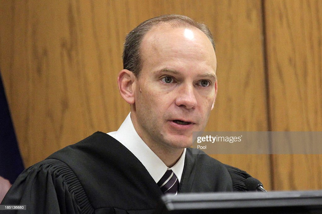 Judge Derek Pullan gives eleven members of the jury instructions as the Martin MacNeill trial starts on October 17, 2013 in Provo, Utah. Dr. Martin MacNeill is accused of killing his wife Michele MacNeill in 2007 to continue an affair with a younger woman.