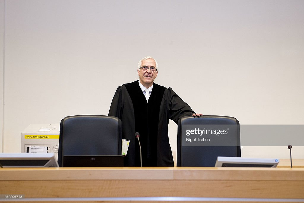 Judge Frank Rosenow arrives in the courtroom at the Landgericht Hannover courthouse for the third day of the trial to Former German President Christian Wulff and defendant David Groenewold on November 27, 2013 in Hanover, Germany. Wulff is accused of accepting favors while he was governor of Lower Saxony, a charge that prompted him to resign last year from his office as president. Wulff is the first post-World War II German president to face a court trial.