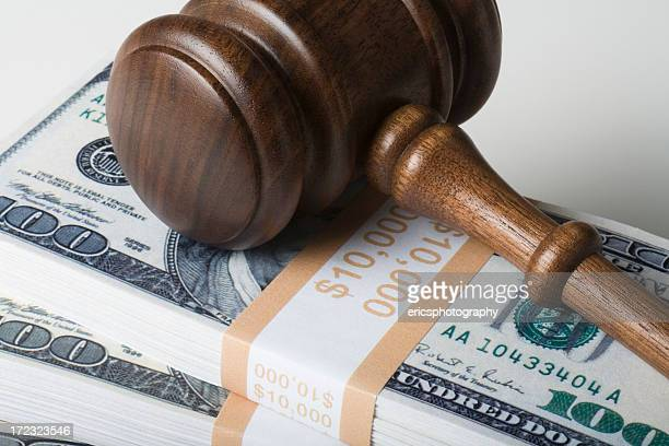 Judge gavel on 100 dollar bills