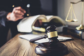 Judge gavel with Justice lawyers, Lawyer or Judge counselor working with agreement contract in Courtroom, Justice and Law concept.