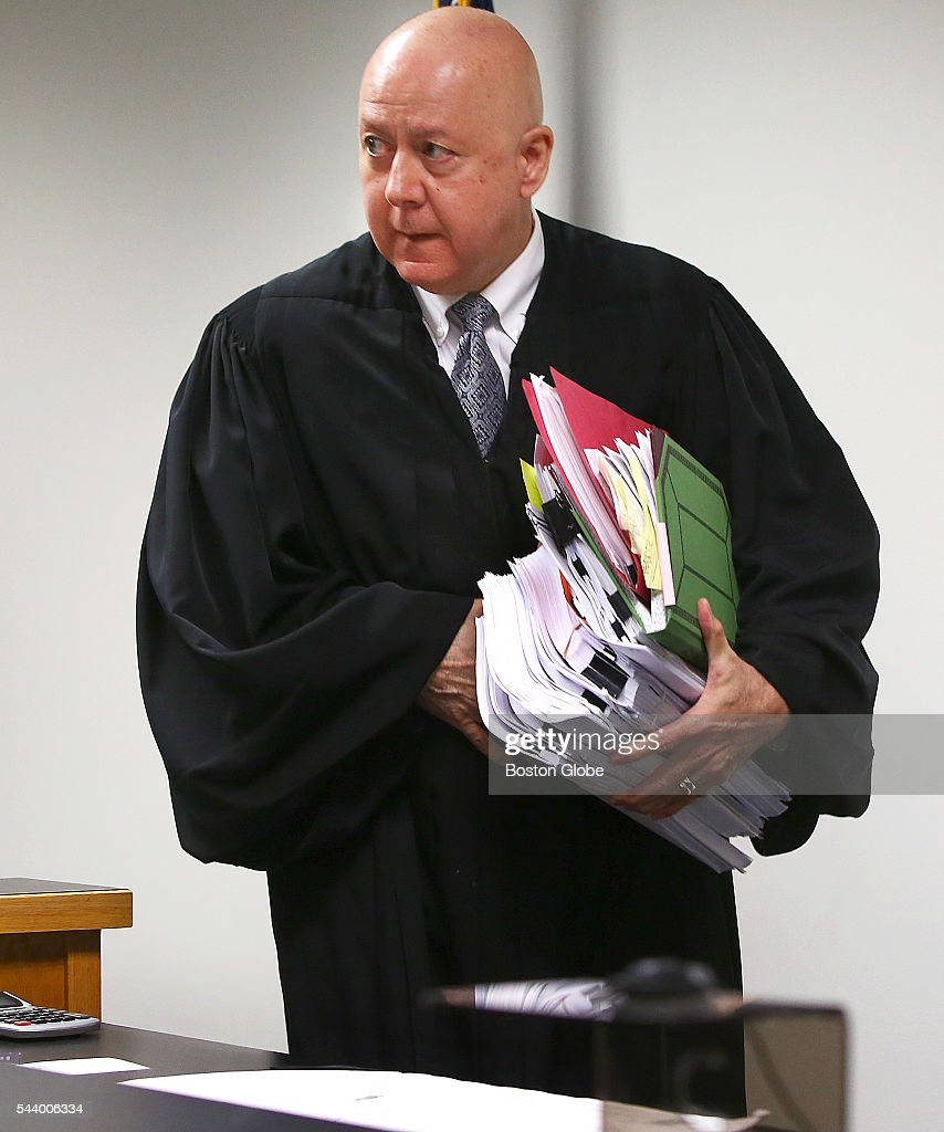 Judge George Phelan enters the courtroom in the morning. Attorneys representing various factions of Sumner M. Redstone's family argue over who should gain control of his media companies, in Norfolk County Probate Court in Canton, Mass., on June 30, 2016.