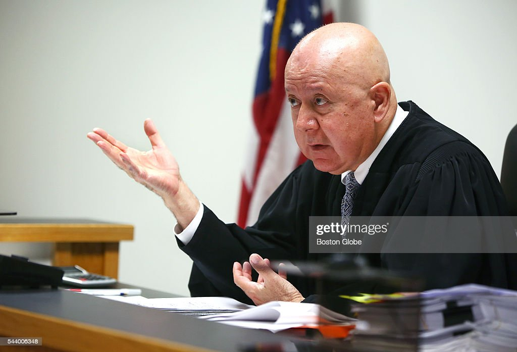 Judge George Phelan gestures. Attorneys representing various factions of Sumner M. Redstone's family argue over who should gain control of his media companies, in Norfolk County Probate Court in Canton, Mass., on June 30, 2016.