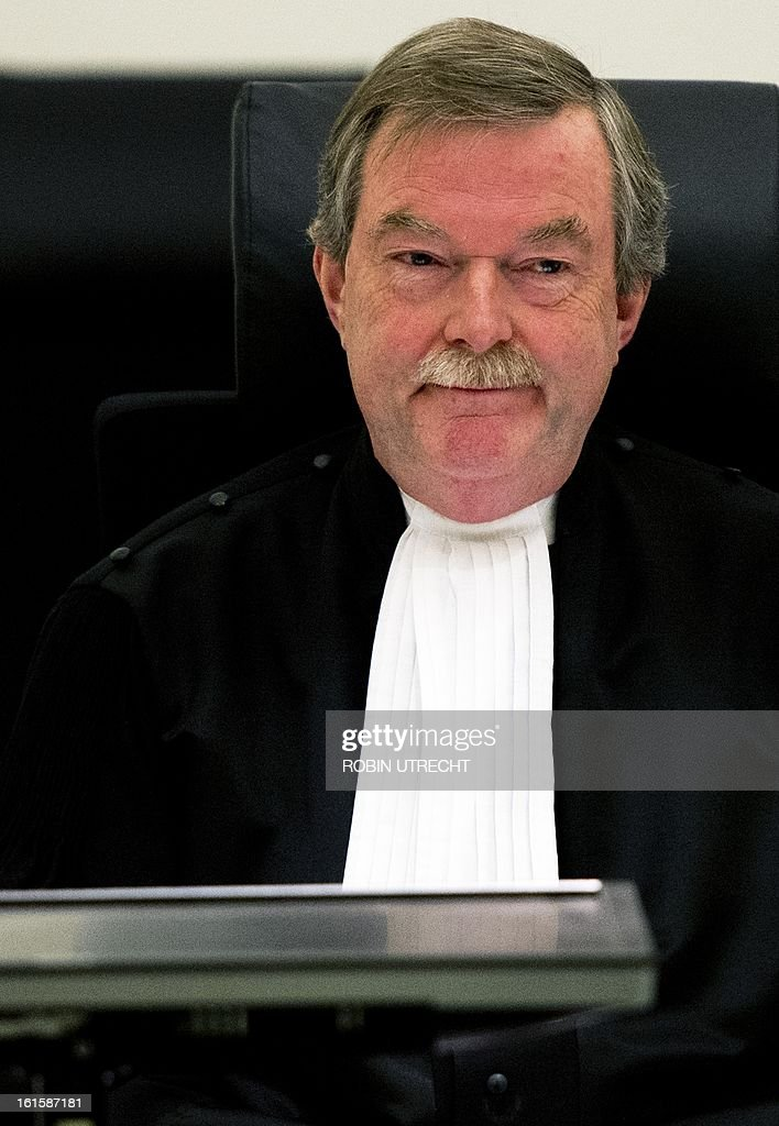Judge Gerard van Ham stands in the courtroom of The Hague, on February 12, 2013, prior to the trial of Dutch-Pakistani national Sabir Khan. His lawyers launch last-ditch effort to stop extradition of Khan to the United States. The US accused Khan of planning at least one suicide attack on a US military target in Afghanistan. AFP PHOTO ANP ROBIN UTRECHT - Netherlands out -