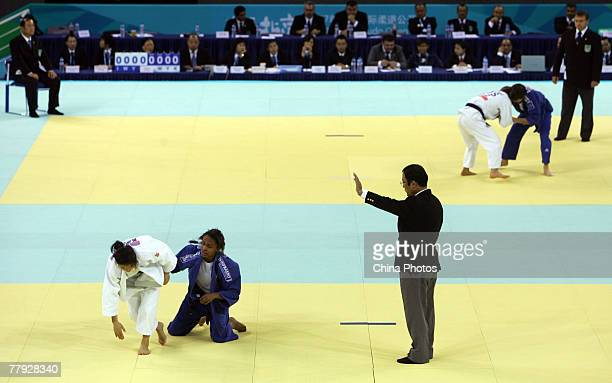 A judge gestures as Erika Miranda of Brazil fights against Bundmaa Munkhbaatar of Mongolie during 52kg category semifinal bout of the Good Luck...