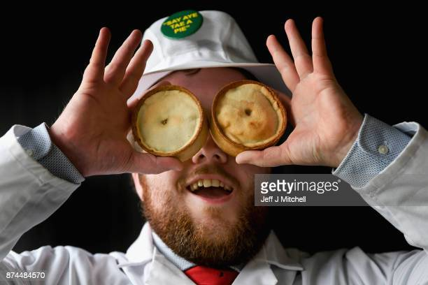 Judge Graeme Sharp poses for a photograph as he views the entries by Scottish bakers for the 19th World Championships on November 15 2017 in...