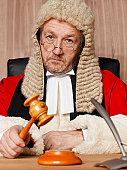 Judge holding gavel, portrait, close-up